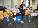 The class rehearse with guest singer, Mel